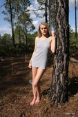 Stunning_blonde_Russian_teen_posing_naked_in_the_woods